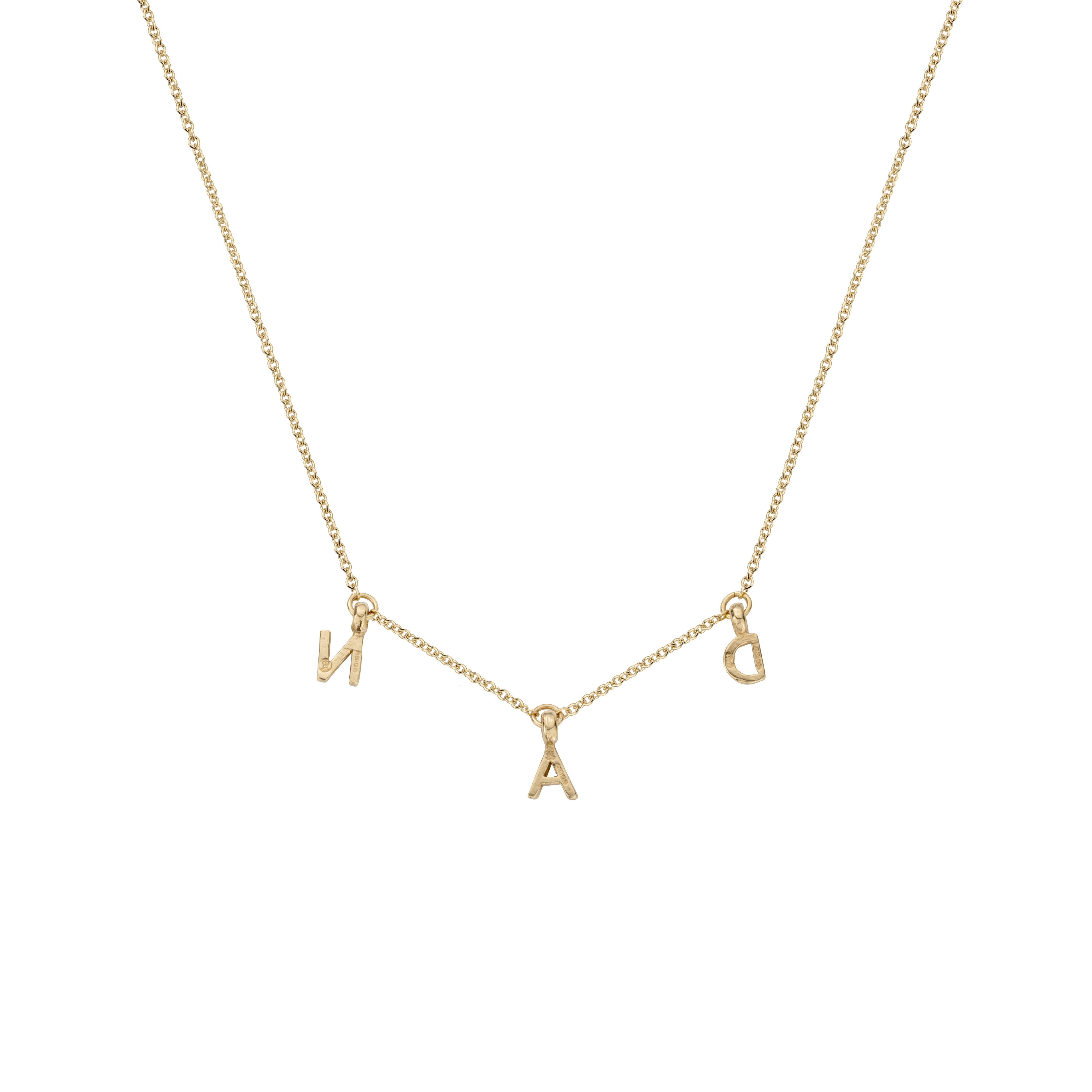 The Duchess of Cambridge was seen wearing Daniella Draper Gold Fixed Alphabet Necklace in May 2021 on the last day of the Scotland tour.